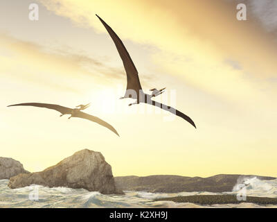 Two pteranodons flying over rocks in the sea - Stock Photo