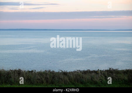 St. Brides Bay sea view from Porthclais Farm campsite near the Wales Coast Path on a summer evening in August Pembrokeshire - Stock Photo