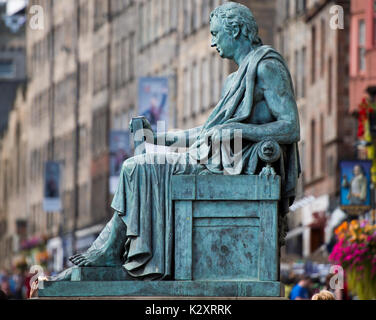 The statue of philosopher David Hume (1711 -1776) sits outside the High Court at the Lawnmarket on Edinburgh's Royal - Stock Photo