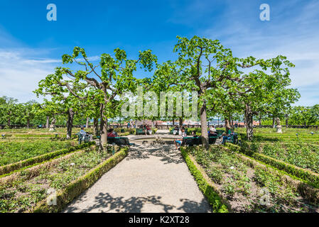 Bamberg, Germany - May 22, 2016: People rest in the Residence rose garden at the world culture heritage city of - Stock Photo