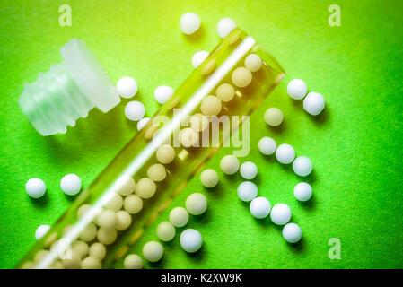 Globuli, homoeopathic medicament, homoeopathisches Arzneimittel - Stock Photo