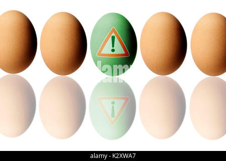 Huehnerei with warning, symbolic photo for Fipronil load with eggs, Huehnerei mit Warnschild, Symbolfoto fuer Fipronil - Stock Photo