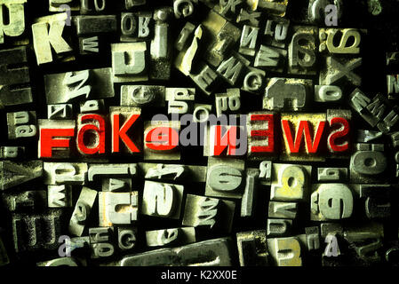 'Stroke ''Fake of news'' from characters of lead', 'Schriftzug ''Fake News'' aus Bleilettern' - Stock Photo