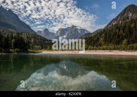 Lake Jasna with the mountain of Prisojnik in the background. - Stock Photo