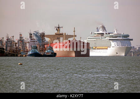 Cruise liner Navigator of the Seas passing the Russian tanker ship Moscow University alongside the Fawley Marine - Stock Photo