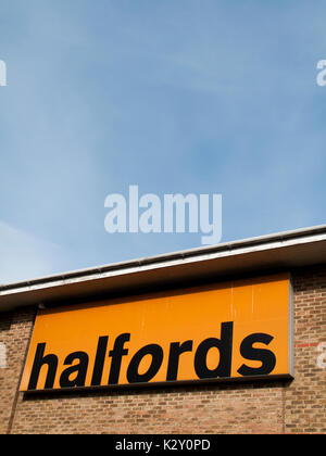 Halfords Group plc, British retailer of car parts, camping, touring equipment, bicycles MOT service and repairs - Stock Photo