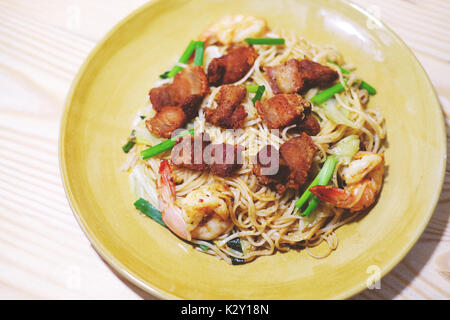 stir fried yellow noodle with crispy pork and prawn,china food style - Stock Photo