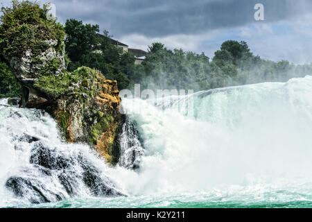 The falls are located on the High Rhine on the border between the cantons of Schaffhausen and Zürich and is the - Stock Photo