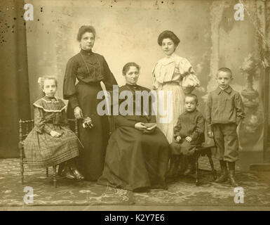 Antique c1900 photograph, mother and children, or mother and children with aunts. SOURCE: ORIGINAL PHOTOGRAPH. - Stock Photo