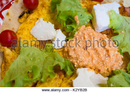 Omelet with tortillas. Cucumber, cherry tomatoes, bacon, ham. Strong breakfast. - Stock Photo