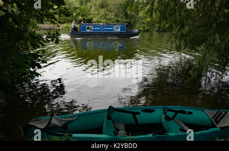 A canal boat on the Thames near Wallingford, England - Stock Photo