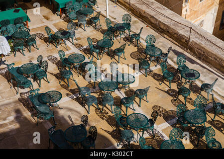 Cafe tables and chairs. View from the top. Rhythmes of Mediterranean island. - Stock Photo