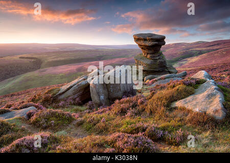 Stunning sunset over the Slat Cellar a weathered rock formation on Derwent Edge high above teh Ladybower Reservoir - Stock Photo