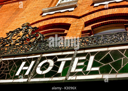 Retro stained glass sign at the Central Hotel, exterior. Red bricks building facade. Travel destinations. Dublin - Stock Photo