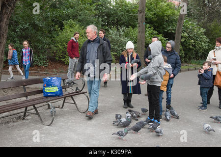 feeding pigeons, St Stephens Green, Dublin, Ireland - Stock Photo