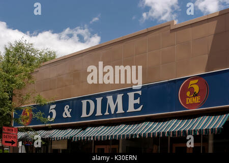 A 5 & Dime store sign still remains from the early 1900s when the store sold many different kind of items which - Stock Photo