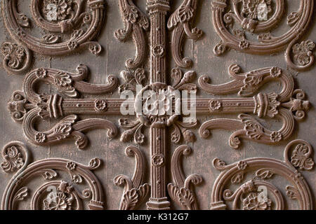 Wooden door of the St. Denis cathedral, Paris, France - Stock Photo