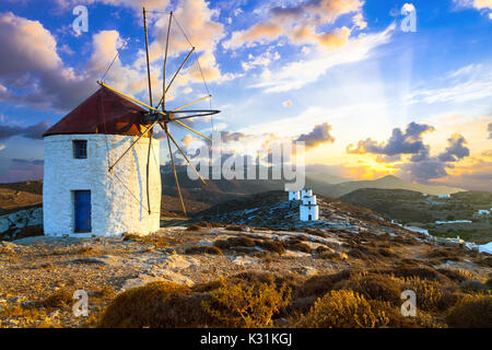 Authentic traditional Greek islands - unique Amorgos. View of Chora village with windmills over sunset - Stock Photo