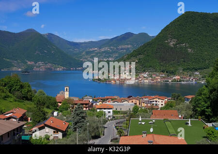 Iseo lake and island Monte Isola in Alps, Lombardy in northern Italy - Stock Photo