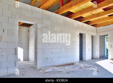 Interior of a new house construction made with aerated concrete blocks. - Stock Photo