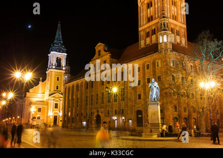 Torun's Old Town Hall at night in the old Market Squre of the Old Town. - Stock Photo