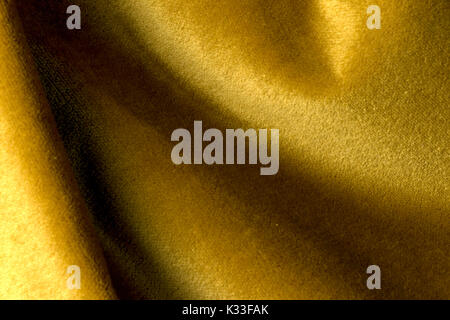 Golden angora goat velours fabric resembling velvet, mixed with natural silk threads. mohair textile. cashmere, - Stock Photo