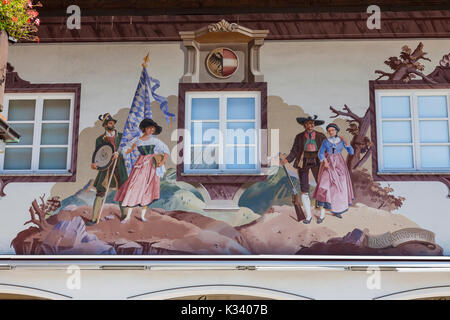 Paintings and frescoes decorate the typical houses Garmisch Partenkirchen Oberbayern region Bavaria Germany Europe - Stock Photo