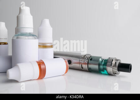 Isolated electronic cigarette with e-liquid or e-juice on a white background. - Stock Photo