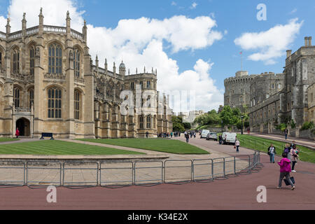 WINDSOR, ENGLAND - JUNE 09, 2017: People visiting Windsor Castle with St George's chapel. Windsor Castle is the - Stock Photo