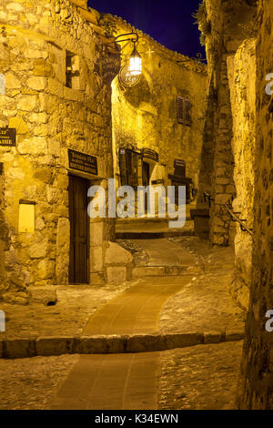 Night view down a narrow road in the medieval town of Eze, Provence, France - Stock Photo