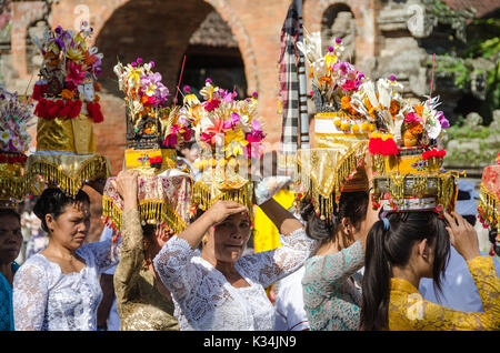 UBUD, BALI - MARCH 16: Balinese villagers participating in traditional religious Hindu procession before Ogoh-ogoh - Stock Photo