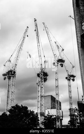 UK residential real estate property industry: Tower cranes on the South Bank Tower construction site, South Bank, - Stock Photo