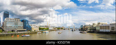 Panoramic cityscape view from London Bridge along the River Thames towards Tower Bridge and HMS Belfast and the - Stock Photo