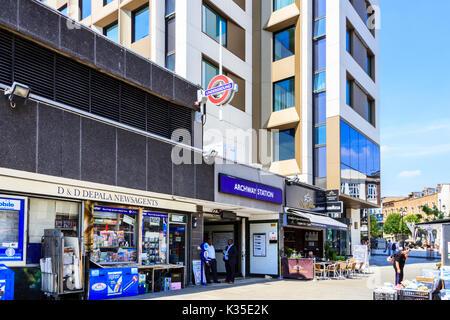 The entrance of Archway tube station on Junction Road and Essential Living's 'Vantage Point' apartment tower block, - Stock Photo