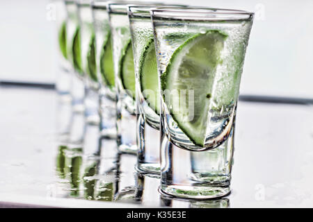 Cocktail. Vodka, gin tequila with lime - Stock Photo