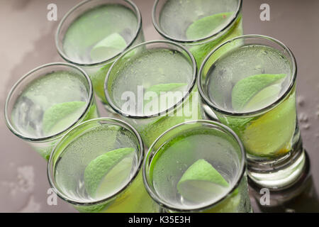 Alcohol cocktail with lime - Stock Photo