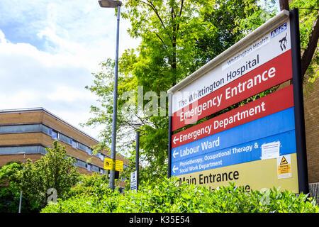 Informational sign showing the Emergency Entrance of the Whittington Hospital, Archway, North London, UK - Stock Photo