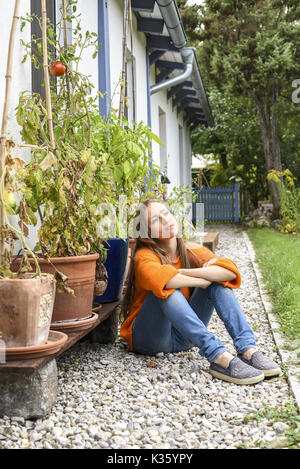 Yound woman in her garden, near Vienna, Austria (model-released) - Stock Photo