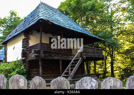 Rustic traditional clay and wood house from Romania - Stock Photo