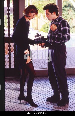 FLIRTING WITH DISASTER TEA LEONI, BEN STILLER stocking top     Date: 1996 - Stock Photo