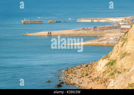 From Ecclesbourne Glen over the sight of the proposed Marina development in the English Channel to Hastings Beach - Stock Photo