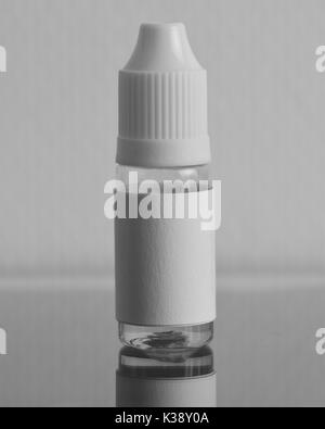 Isolated e liquid bottles for vaping devices, e cigarette, electronic cigarette, over a black background. - Stock Photo