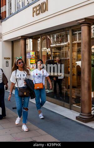 Fashionable Young Women Shopping In New Bond Street, London, UK - Stock Photo