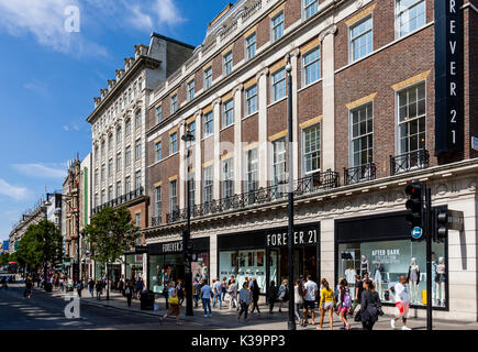 People Shopping In Oxford Street, London, UK - Stock Photo