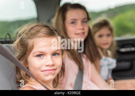little girls inside car - Stock Photo