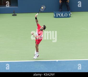 New York, United States. 31st Aug, 2017. Roger Federer of Switzerland serves during match against Mikhail Youzhny - Stock Photo