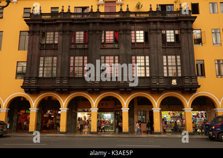 Ornate wooden balconies on historic building in Plaza Mayor, Historic centre of Lima (World Heritage Site), Peru, - Stock Photo