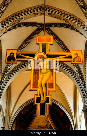 Crucifix by Giotto in Santa Maria Novella church in Florence Italy - Stock Photo