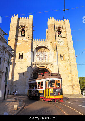 LISBON, PORTUGAL - July 05, 2017: Famous yellow tram running in front of Se Cathedral in Lisbon, Portugal. - Stock Photo