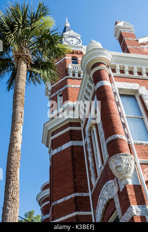 Brunswick Georgia Old Town Historic District Newcastle Street Old City Hall Romanesque Revival architecture clock - Stock Photo